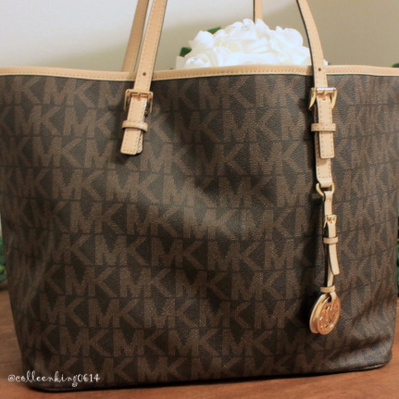 e07b88a3428e Michael Kors Brown Monogram Jet Set Travel Tote. M_5b27220a6a0bb7bc548433b4